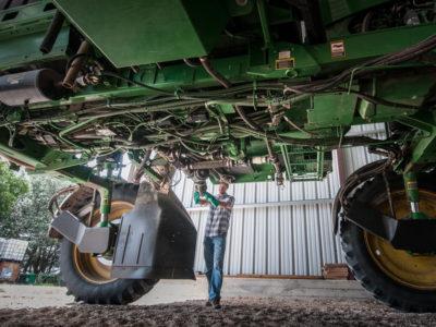 Farmer repairing