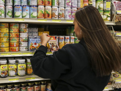 Customer examining food label