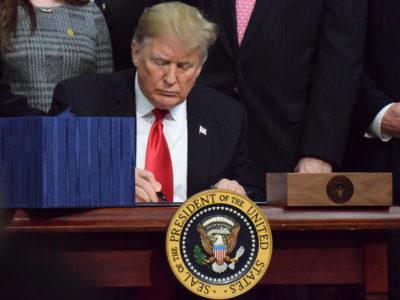 Trump signing the farm bill