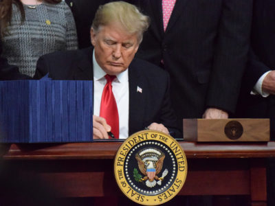 Trump signing the farm bill