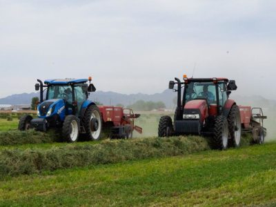Two tractors baling hay