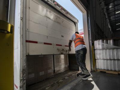 Worker closing truck