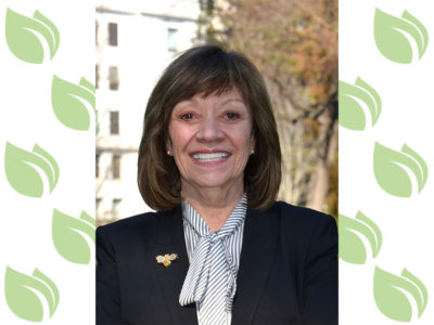Headshot of Secretary Karen Ross on an Agri-Pulse background.